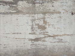 Detail of a vintage door with flaking white paint