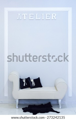 detail of a waiting area of a sewing atelier - useful as a background - focus on the L letter Stock fotó ©