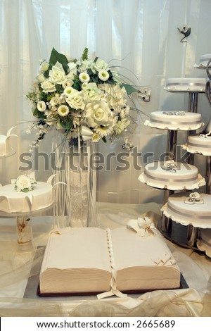 stock photo Detail of a wedding cakes and white wedding bouquet