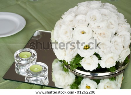 stock photo detail of a wedding table with estomas flowers arrangement and