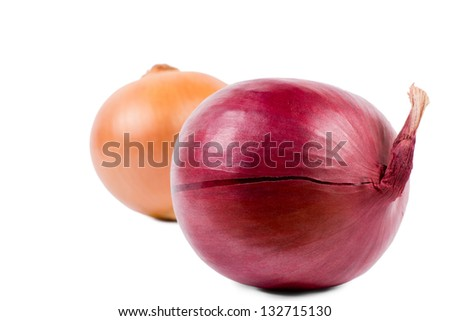 Detail of a whole fresh red onion with a brown onion behind on a white background