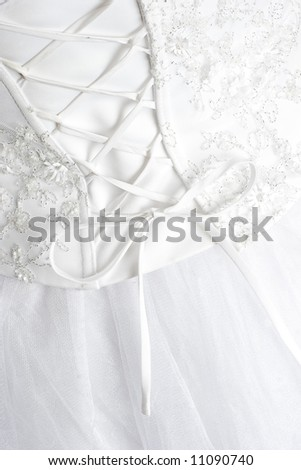 Detail of a woman 39s wedding dress gown showing curve of back with corset