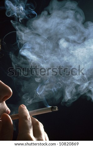 detail of a woman smoking a cigarette