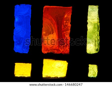 Detail of abstract design of stained glass window made of blue, red and yellow chipped slab glass