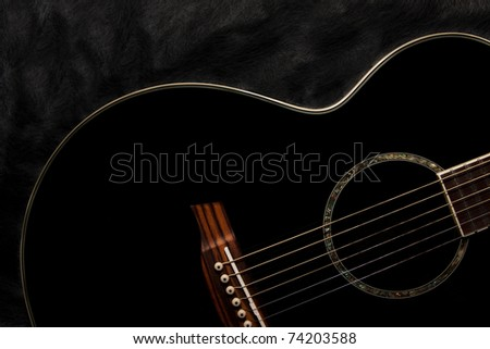 Detail of an acoustic black guitar