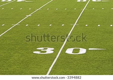 Detail of an American football field - 30 yard line.