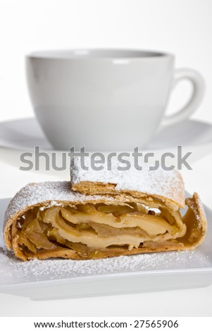 detail of an apple strudel with icing sugar
