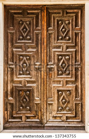 detail of an elegant and luxurious old door located in Italy
