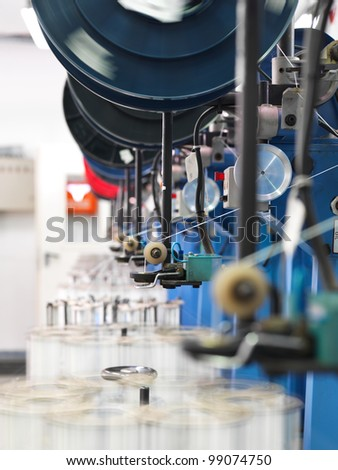 detail of an indoor industrial production line, in a thread factory