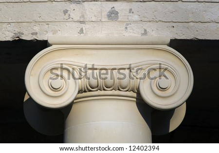 Detail of an ionic order capital from an ancient Greek temple column