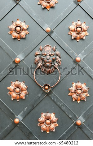 Detail of an iron door with the handle in the form of a head of a lion. Lvov, Ukraine - stock photo