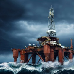 Detail of an Offshore Oil Platform standing in the middle of ocean sea water during dark cloudy day, with high waves and storm
