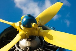 Detail of an old airplane's yellow propeller