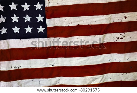 Detail of an old and ripped USA flag