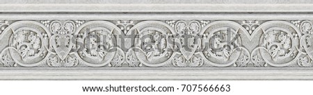 Detail of an old Italian molding stone eaves with foliage and plants #707566663