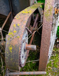 Detail of an old rusted peasant seed drill, chain pinion
