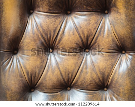 Detail of an old vintage brown couch with buttons - stock photo
