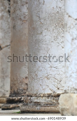 Detail of ancient columns of a Roman temple building in Pula, Croatia #690148939