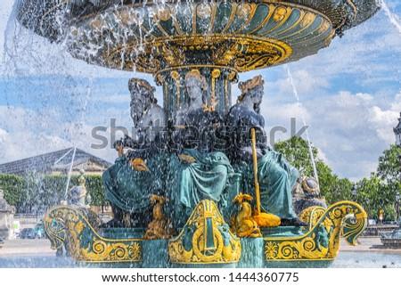 Detail of ancient Fontaines de la Concorde (1840) on Concorde Square (Place de la Concorde) in Paris, France.  #1444360775