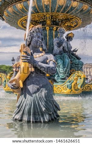 Detail of ancient Fontaines de la Concorde (1840) on Concorde Square (Place de la Concorde) in Paris, France.  #1461626651