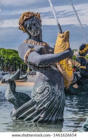 Detail of ancient Fontaines de la Concorde (1840) on Concorde Square (Place de la Concorde) in Paris, France.  #1461626654