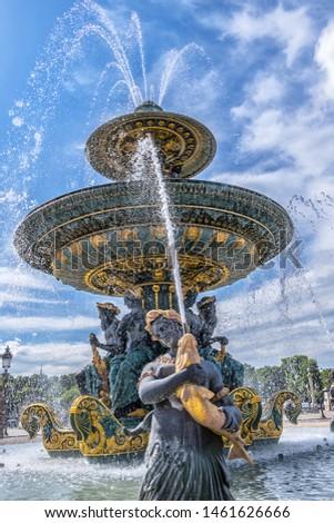 Detail of ancient Fontaines de la Concorde (1840) on Concorde Square (Place de la Concorde) in Paris, France.  #1461626666