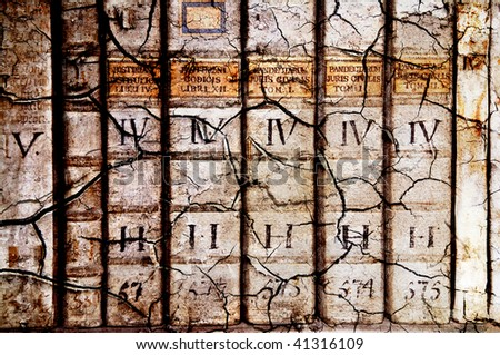 Detail of ancient medieval book backbones - tomes about law in latin in grunge style wit cracks