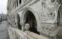 detail of Angle of Ducal Palace in Venice during high tide in winter