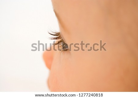 Detail of baby girls face with close up on eye and eyelashes