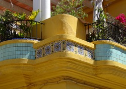 Detail of balcony decorated with tiles in an Art-Deco house in Cabanyal Quarter in the city of Valencia. Spain.