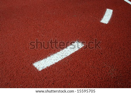 Detail of basketball field with rubber floor and markings on it