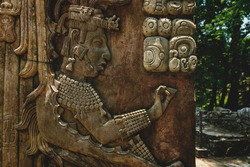 Detail of Basrelief carving of Mayan king and signs at the archaeological site of Palenque, Chiapas, Mexico