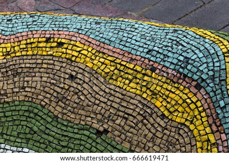 Detail of beautiful old collapsing abstract ceramic mosaic adorned building. Venetian mosaic as decorative background. Selective focus. Abstract Pattern. Abstract mosaic colored  ceramic stones #666619471