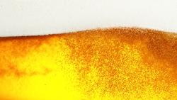 Detail of beer drink with foam head, super macro shot