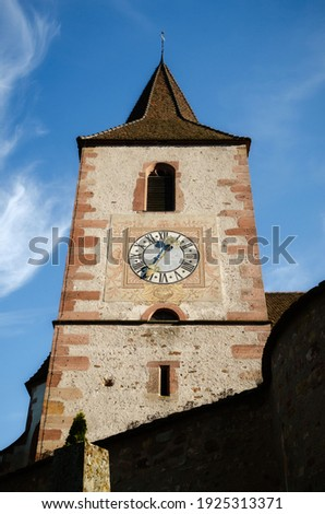 Detail of bell tower and cloch of the medieval church of Saint-Jacques-le-Major in Hunawihr, village between the vineyards of Ribeauville, Riquewihr and Colmar in Alsace, wine making region of France Photo stock ©