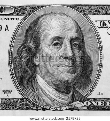 Detail of Benjamin Franklin's portrait on one hundred dollar bill.