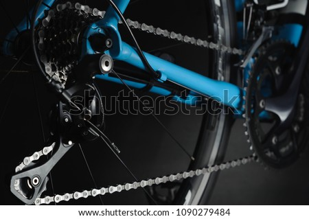 Detail of bicycle components. Close up cassette, chain and rear derailleur. Studio photo