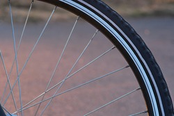 Detail of bicycle wheel, spokes, and tire, close up