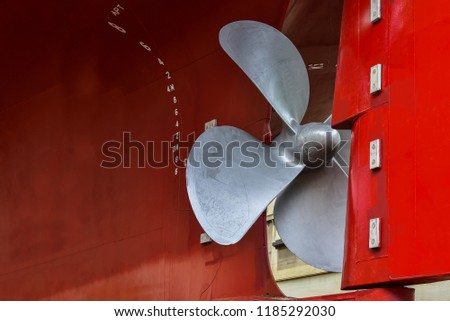 Detail of black stern and close up ship propeller rudder in floating dock under maintenance and repair already, after sandblasting and painting approved and witnessed by surveyor in shipyard
