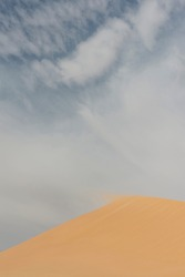 detail of blowing sand in the wind off or over the top of a sanddune, rescaping the landscape and forming new sanddunes in the Egyptian Western Desert