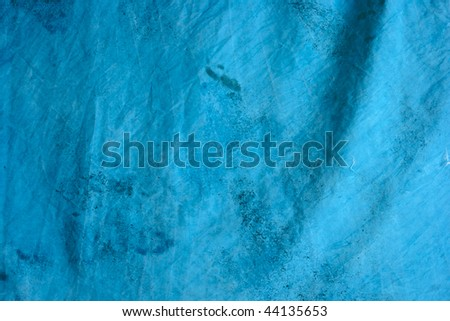 detail of blue mottled tie dyed background fabric.