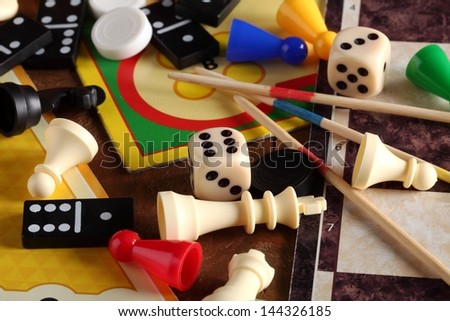 Detail of board games, pawns, chessmen, dominoes, mikado sticks and dices