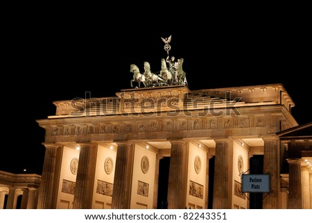 Detail of Brandenburg Gate by night. In german it is called Brandenburger Tor and it's one of the few monuments that survived in the defeated capital town of Berlin after second world war.