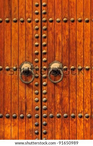 Detail of Brass Doorknobs on Exterior of old  Door in Morocco - stock photo