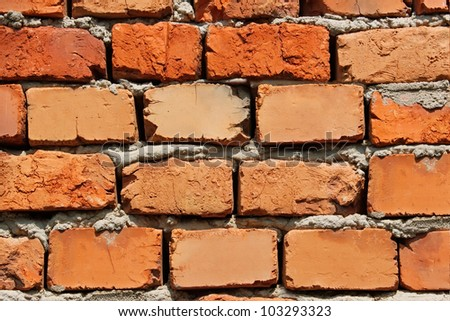 Detail of brick wall with bricks of different colors