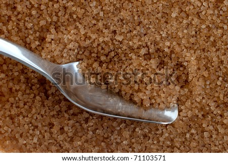 Detail of Browm sugar and spoon from sugar cane - useful as a background.
