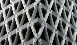 Detail of brutalist concrete diamond shaped facade of the car park in Welbeck Street , London.