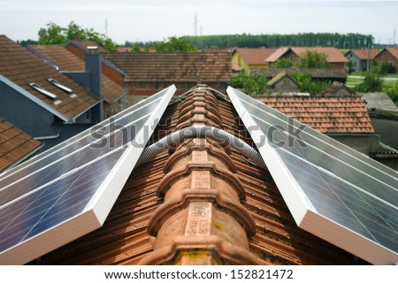 Detail of cable connecting solar panels on the roof