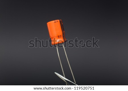 Detail of capacitor in black background