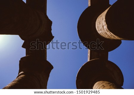 Detail of capitals on columns made by the ancient Egyptians and sunlight at the Karnak Temple near Luxor. Known as the largest open air museum in the world, it has many temple and tomb ruins in Egypt. #1501929485